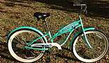 Sweet 24'' ladies beach cruiser found at a local garage sale for $15.00. Just needed new inner tubes and a good cleaning.