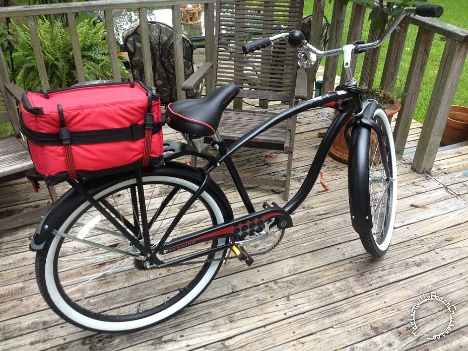 New Schwinn Del Mar plus a horn, bike lock, and a couple of bungee cords. Cooler strapped on the rack.