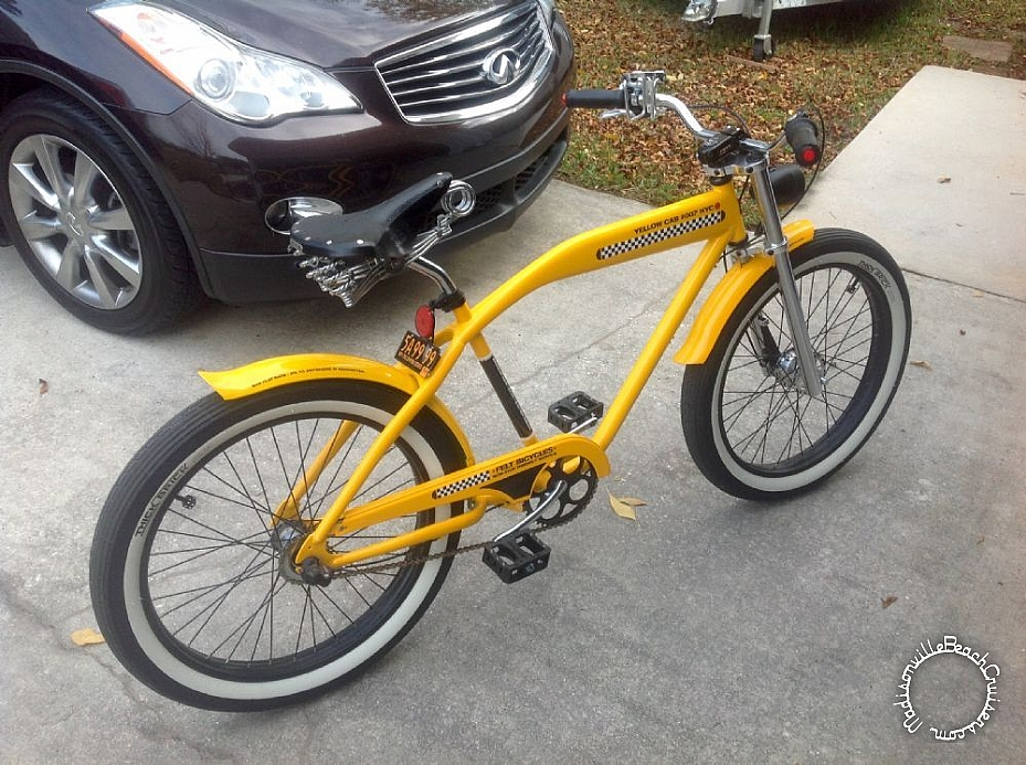 2007 Felt Taxi with double crown fork, Sturmey Archer drum brake, leather grips, Brooks B33, lay back seat post, Nirve drink caddy, Primo Super Tenderizer pedals, custom LED tail light, and 1954 New York license plate.