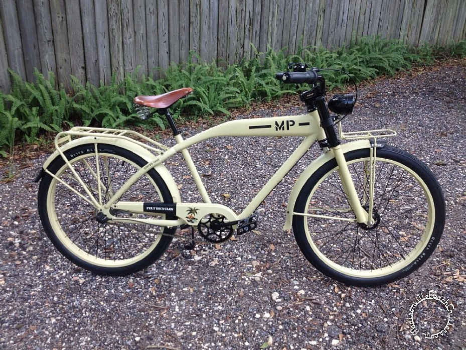 Felt MP Rat Patrol, Quick Brick tires, Dual bulb headlamp, Brooks B67, Primo Super Tenderizer pedals, Velo leather grips,  Nirve drink caddy, and black bell.
